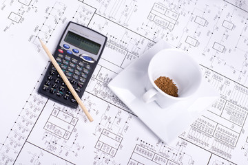 Calculator, pancil, cup of coffee and detail drawing