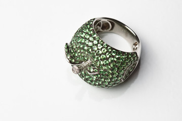 White gold ring with emeralds in the shape of an apple