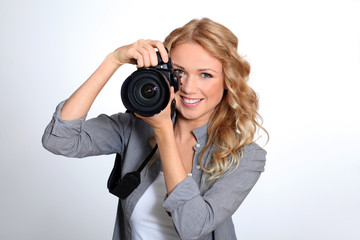 Woman using photo camera in studio