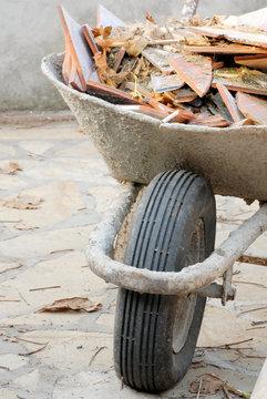 Wheelbarrow with construction waste