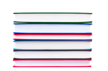 Stack books with color covers, isolated on white background.
