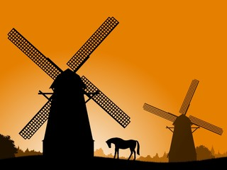 A silhouette of a windmill and a horse.