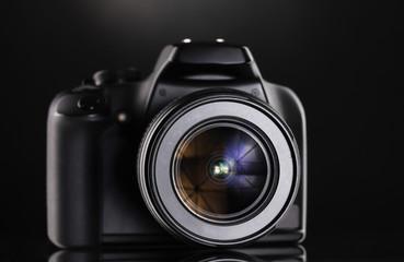 Black photocamera on black background