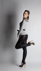 Fashion girl posing in the studio