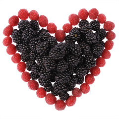 Heart made out of raspberries and blackberries