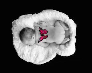 selective image of newborn sleeping with butterfly on back