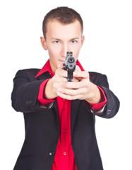 gunman ready to shoot, white background. focus on gun