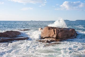Ocean waves breaking at  the granite coast of France, Brittany Wall mural