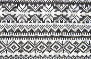 gray background with a knitted pattern