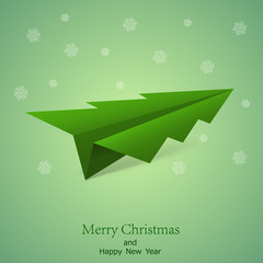 Concept of the Christmas tree and origami airplane.