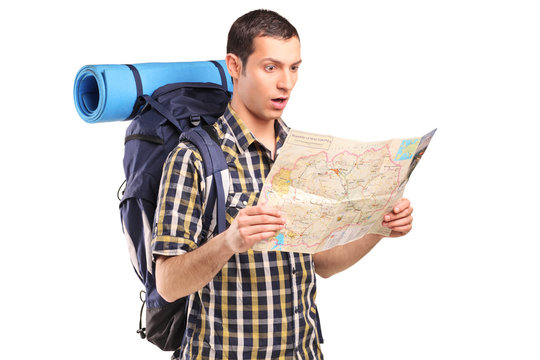 A lost hiker looking at map