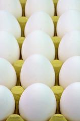 White eggs in yellow box