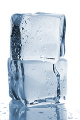 Two ice cubes with water drops
