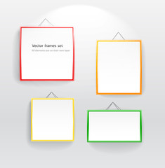 Blank color boards different sizes on wall