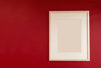 Picture frame on colorful red wall