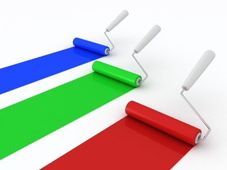 colorful paint rollers on white background