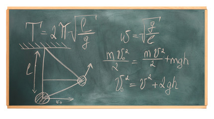 formulas written on green chalkboard