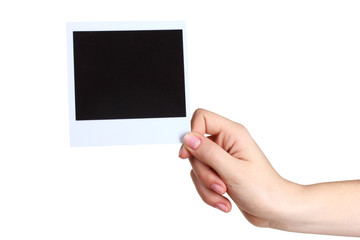One photo paper in hand isolated on white