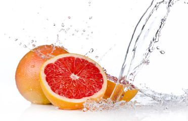 Deurstickers Opspattend water Grapefruit slice in water splash, isolated on white background