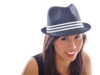 smiling girl wearing fedora hat