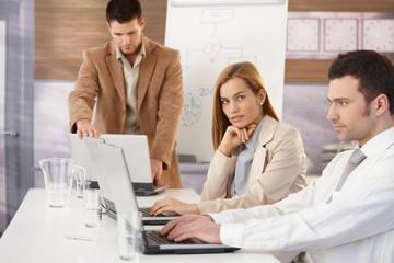 Confident businesswoman at training