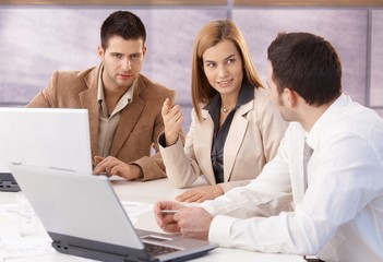 Young professionals teamworking in meeting room
