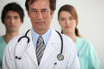 A doctor with his two interns