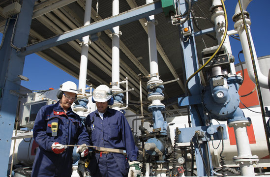 oil workers at refinery filling station
