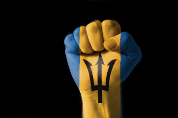 Fist painted in colors of barbados flag