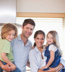 Smiling family standing up