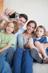 Portrait of a family taking a photo of themselves