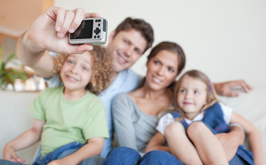 Happy family taking a photo of themselves