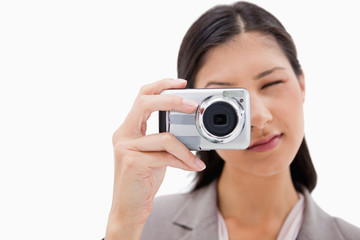 Businesswoman using camera