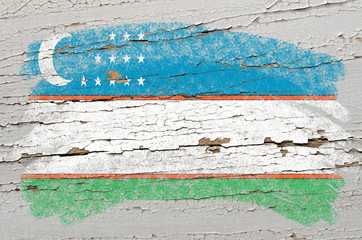 flag of uzbekistan on grunge wooden texture painted with chalk