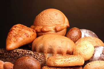 delicious bread on wooden table on brown background