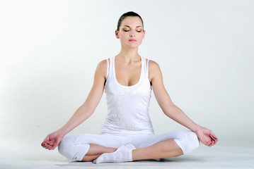 The young beautiful girl is engaged in yoga