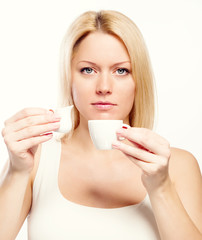 Attractive woman holding cup of coffee and cream