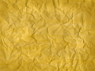 Crumpled yellow paper texture