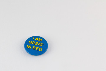 Button with provocative slogan