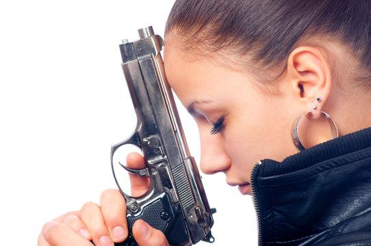 Portrait of beautiful girl in black leather jacket holding gun