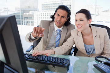 Working business team using a computer