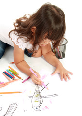 Girl coloring on paper