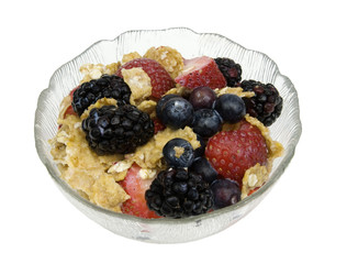 fresh bowl of healthy muesli on a white background