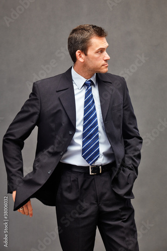 man with black suit and blue tie