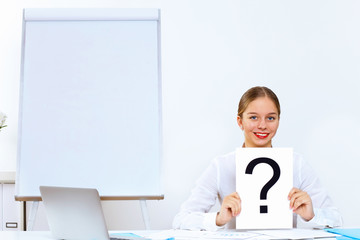Young woman generating ideas in office