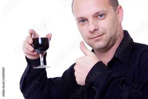 homme avec verre de vin rouge a la main et pouce lev oenologue photo libre de droits sur la. Black Bedroom Furniture Sets. Home Design Ideas