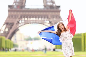France - french flag woman by Eiffel tower, Paris