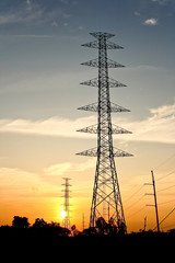 electricity post with sunset