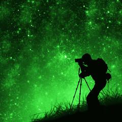silhouette of photographer shooting stars
