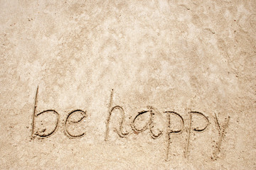 Be happy handwritten in sand for natural, symbol,tourism